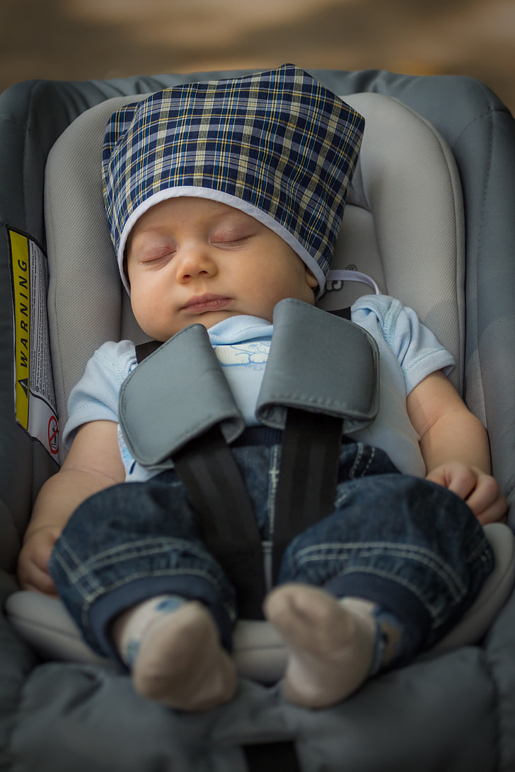 baby sleeping on convertible car seat
