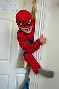 boy wearing Spider-Man costume