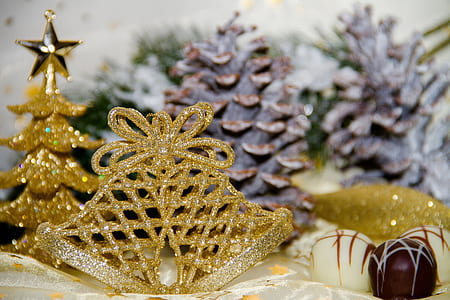 gold-colored tiara near gold Christmas tree