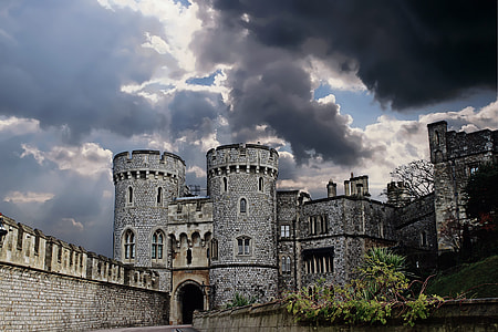grey concrete castle under blue dark sky