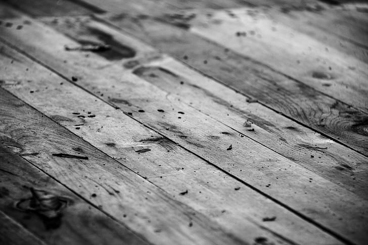 wood planks in greyscale photography