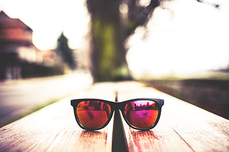 Red Fashion Glasses on Wooden Table