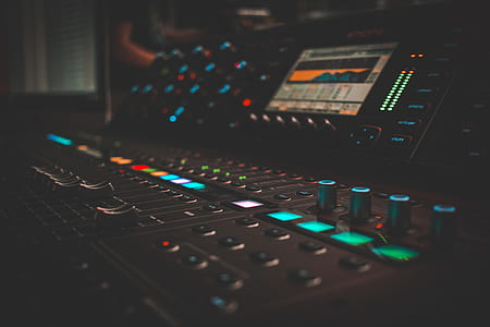 photo of black and green lighted mixing console