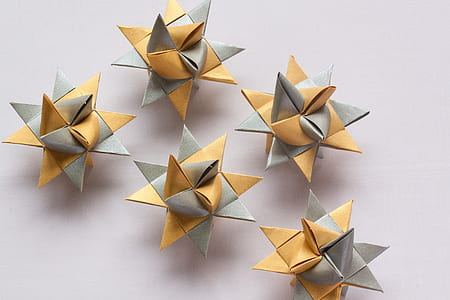 several orange-and-gray origami on gray surface