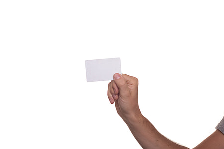 person's right hand holding white card