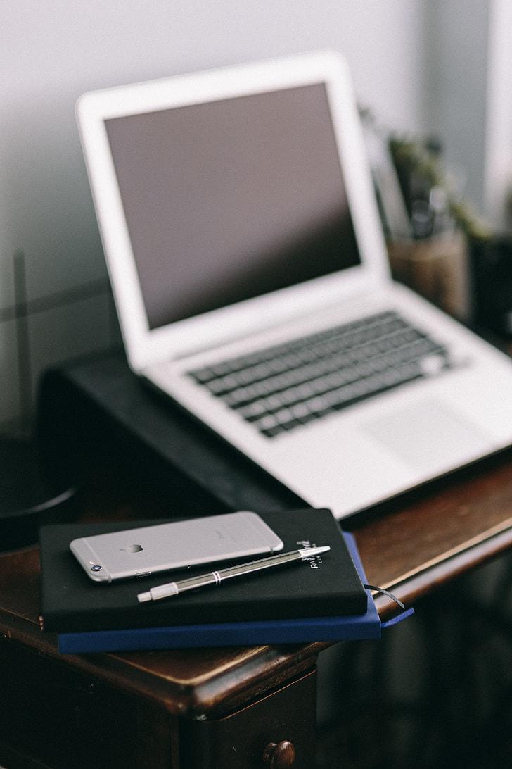 Royalty free photo elegant workspace with macbook iphone business elegant workspace with macbook iphone business cards and notebooks reheart Choice Image