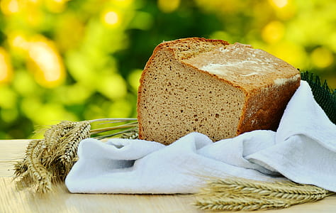 Brown Loft Bread in White Textile on Beige Table