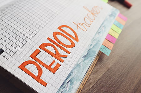 Period Trackers Written on Graphing Notebook