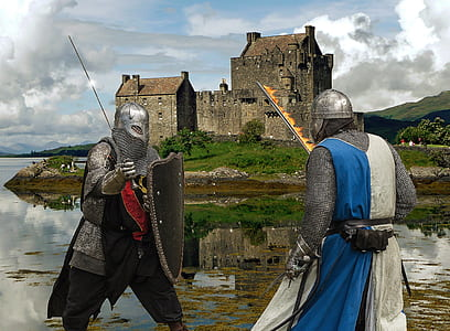 two men wearing armor with castle background