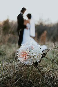 photo of white flower with newly wed background