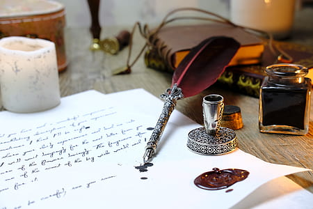 silver fountain pen on white paper