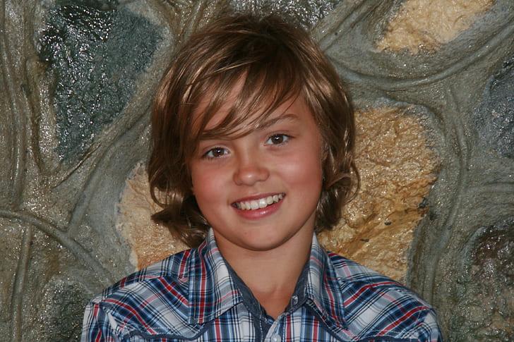 boy wearing button-up shirt
