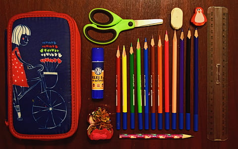 coloring pencils near on scissor and eraser