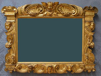 photo of cherub embossed brass-colored photo frame