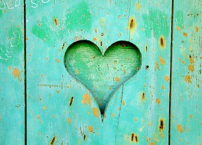 green wooden heart wall art