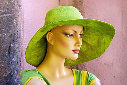 green hat and green dress on mannequin