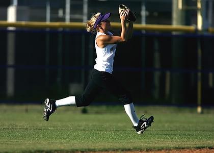Woman in White Sleeveless Shirt Playing Softball