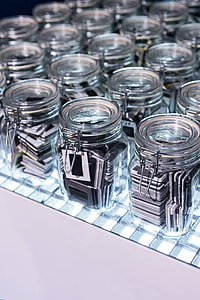 Collection of glass jars with miscellaneous items