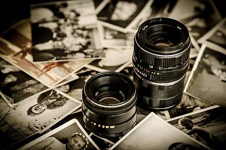 black DSLR camera lens on photo