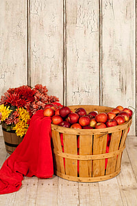 red apples in brown wooden container