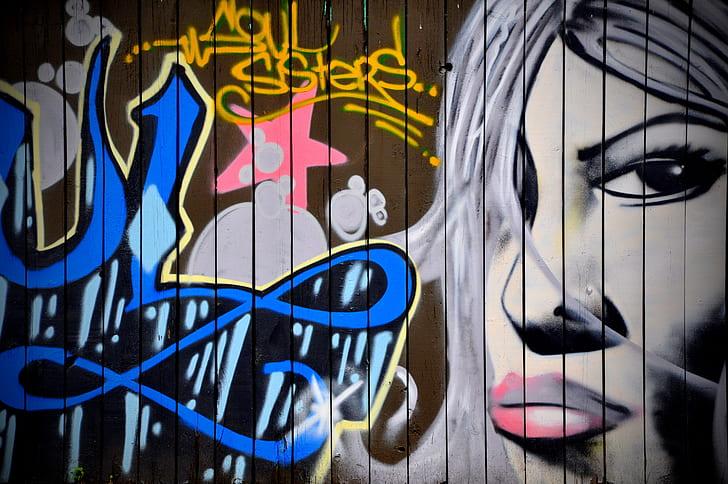 art illustration on blue wooden fence