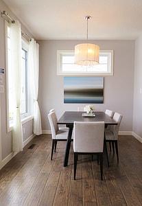 rectangular brown-top dining table