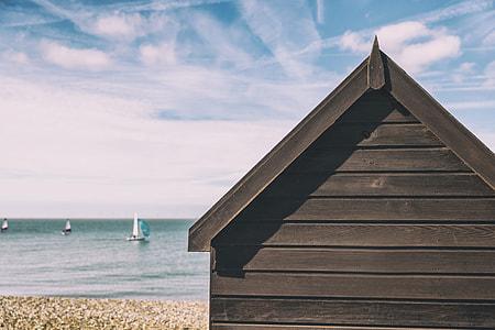Summer beach hut house on the coast on a sunny summer day