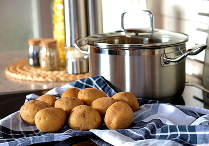 stainless steel cooking pot near potatoes