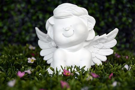 cherub ceramic figurine