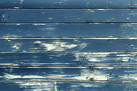 closeup photography of blue and white wooden pallet board