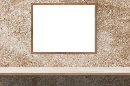 brown wooden framed cork board