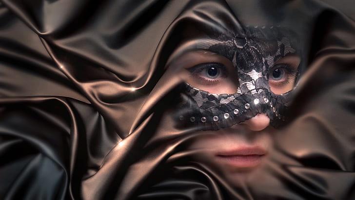 woman wearing black mask
