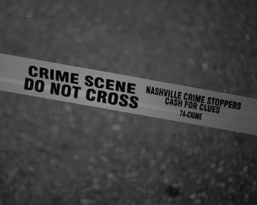 Grayscale Photo of Crime Scene Do Not Cross Tape