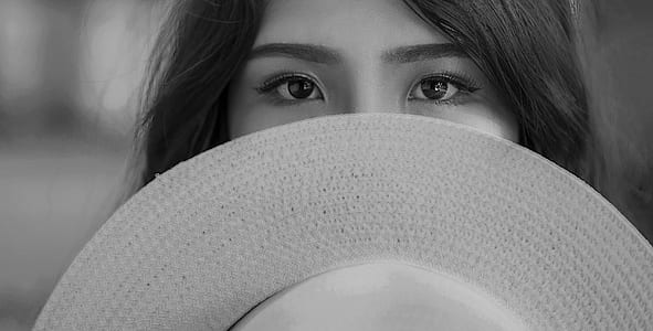 Grayscale Photography of Woman Covering Her Face With Sun Hat