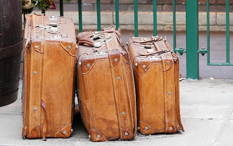 three brown leather luggage set