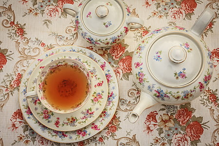 white and multicolored floral ceramic tea set
