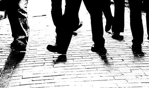 silhouette of human feet walking on ground