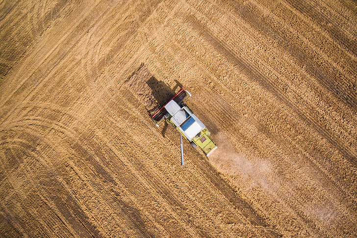 Combine Harvester at Work from Bird's Eye View