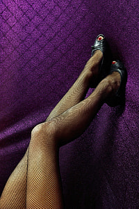 woman wearing black mesh stockings